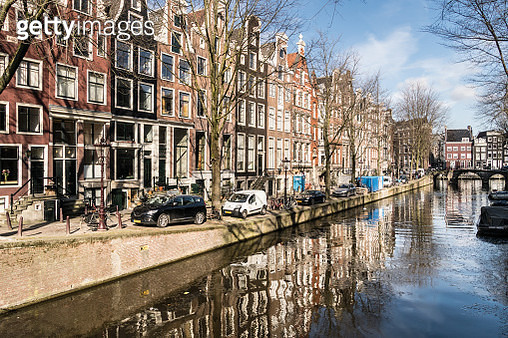 Amsterdam canal reflection on sunny winter day - gettyimageskorea