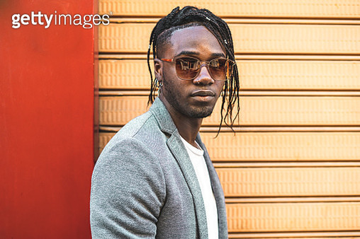 Portrait Of Young Man Wearing Sunglasses Against Wall - gettyimageskorea