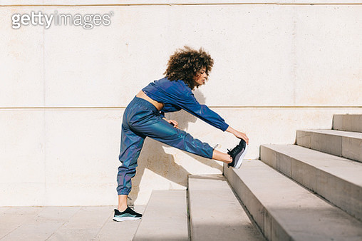 Stylish young woman doing outdoor workout - gettyimageskorea
