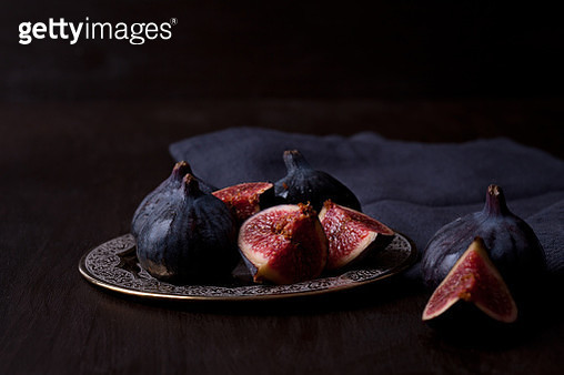 Close-Up Of Fruits On Table Against Black Background - gettyimageskorea