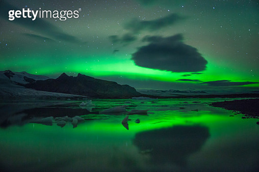 Scenic View Of Aurora Borealis Over Lake Against Sky At Night - gettyimageskorea