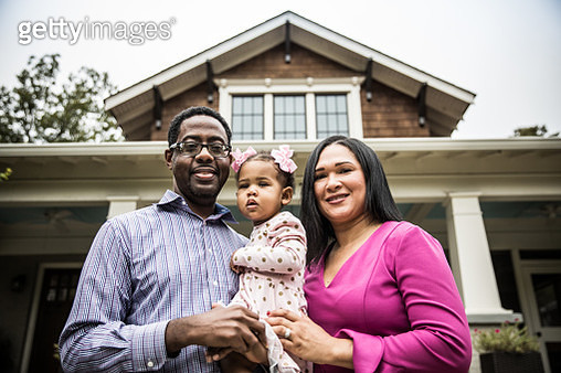 Portrait of family outside of home - gettyimageskorea