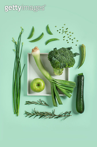 Various green colour fruit and vegetables on green background. - gettyimageskorea