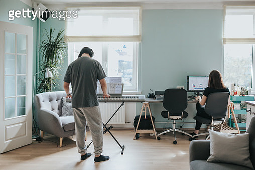 Japanese man plays synthesizer at home during social distancing and lockdown - gettyimageskorea