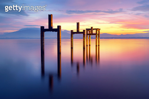 The view of the sea reflects the morning.Three steel towers on the sea - gettyimageskorea