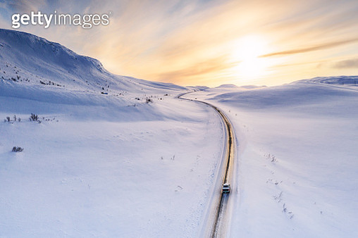 Pick-up truck traveling on snowy road, Sennalandet, Finnmark, Norway - gettyimageskorea