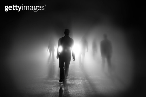 Silhouettes of people walking into light - gettyimageskorea