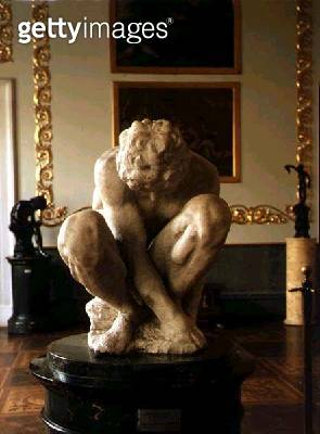 <b>Title</b> : Crouching Boy, sculpture by Michelangelo Buonarroti (1475-1564), c.1530-34 (marble) (front view)<br><b>Medium</b> : marble<br><b>Location</b> : Hermitage, St. Petersburg, Russia<br> - gettyimageskorea