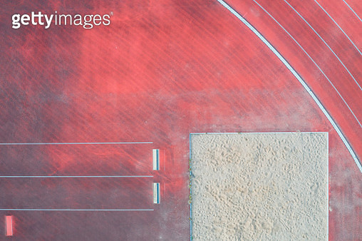 Aerial view of sports venue with running track and long jump pit. - gettyimageskorea