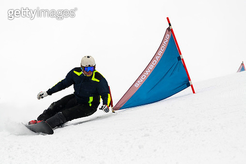 Shot of Young Adult Snowboarder at Giant Slalom Practice - gettyimageskorea