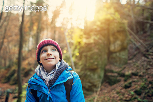 Little boy hiking in autumn forest - gettyimageskorea