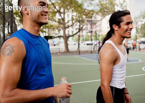 Men laughing on basketball court - gettyimageskorea