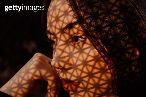 Close-Up Of Thoughtful Woman With Shadow - gettyimageskorea