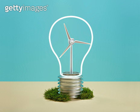 A windmill inside a neon light with the shape of a light bulb - gettyimageskorea