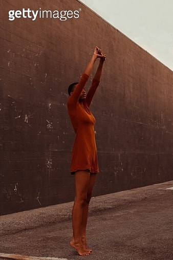 Full Length Of Woman Stretching Against Wall - gettyimageskorea