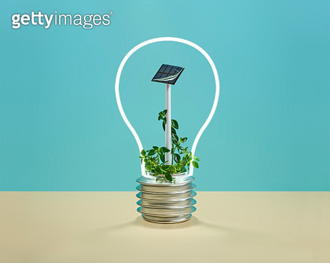 A solar panel inside a neon light with the shape of a light bulb - gettyimageskorea