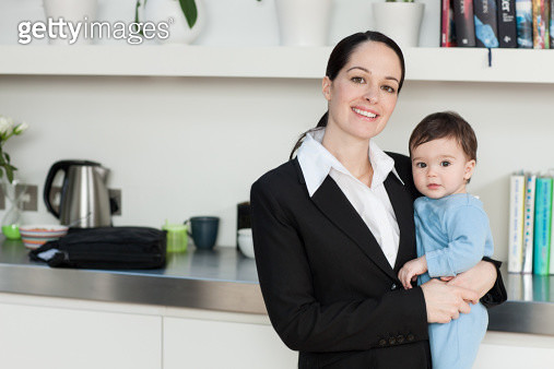 Businesswoman holding baby son - gettyimageskorea