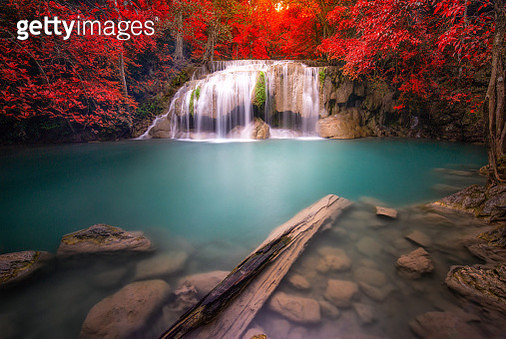 Waterfall in autumn forest at Erawan National Park - gettyimageskorea