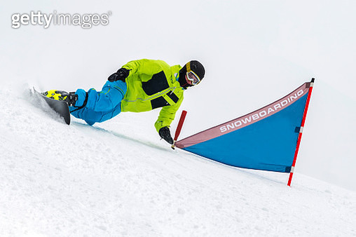 Shot of Young Snowboarder at Giant Slalom Practice - gettyimageskorea