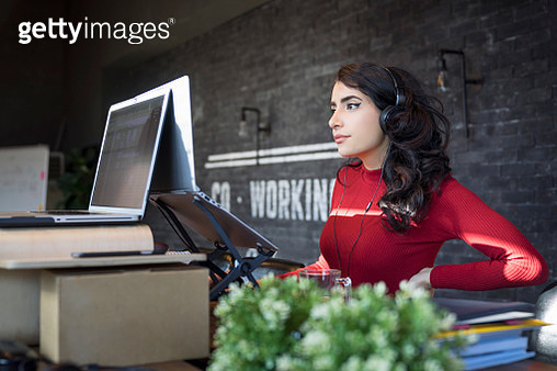 Creative professional working in modern office - gettyimageskorea