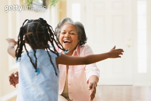 African grandmother and granddaughter running to hug each other - gettyimageskorea