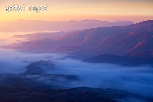 Flowing like the river. Carpathian landscape in warm and cold colors. Red trees on the hill - gettyimageskorea