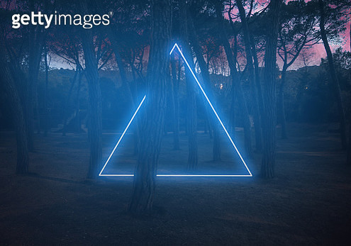 Light painting performance at night in the forest. - gettyimageskorea