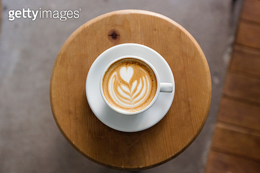 View of coffee cup with latte art straight from above - gettyimageskorea