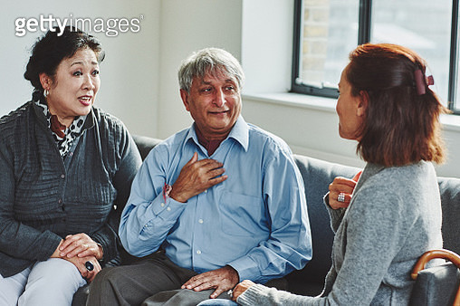 Female carer treating senior couple - gettyimageskorea