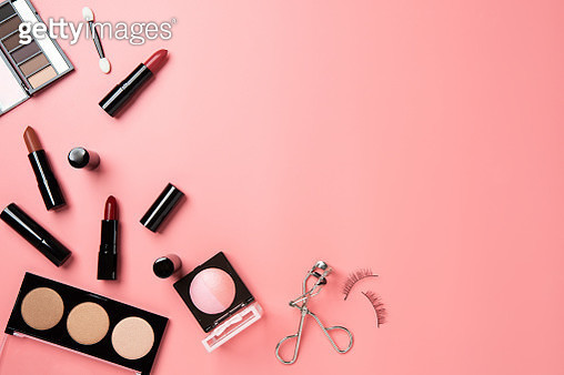 Directly Above Shot Of Beauty Products Over Peach Background - gettyimageskorea