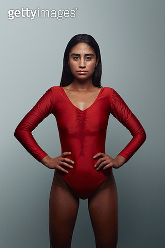 Cool female gymnast looking in camera, wearing leotard - gettyimageskorea