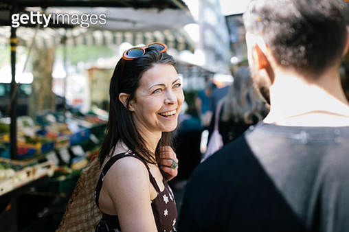 Woman with Boyfriend shopping at Farmer Market - gettyimageskorea