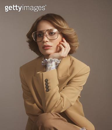 Fashionable woman in beige suit, 70s style - gettyimageskorea