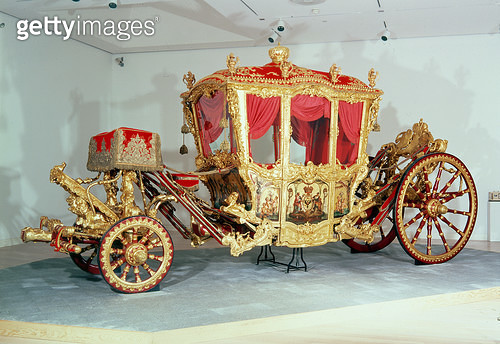 <b>Title</b> : Grand coach, with painted panels ascribed to Francois Boucher (1703-70), Paris, c.1724 (wood, gold and silver)<br><b>Medium</b> : wood, gold, silver, iron, bronze, steel, glass<br><b>Location</b> : Hermitage, St. Petersburg, Russia<br> - gettyimageskorea