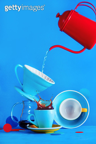 Coffee cup with a splash, pour over and a kettle on a vibrant blue background with copy space. Color block style alternative coffee brewing equipment. - gettyimageskorea