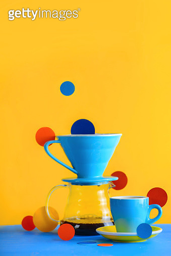 Color block coffee equipment still life. Pour over and porcelain coffee cups on a vibrant yellow background. Geometry and color in food photography. Suprematic concept with copy space - gettyimageskorea