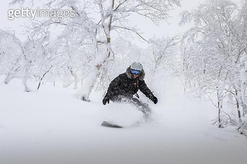 Woman Skiing On Snow - gettyimageskorea