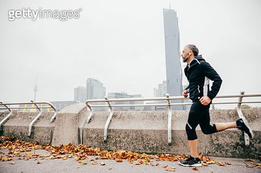 Austria, Vienna, athlete running on Donauinsel - gettyimageskorea