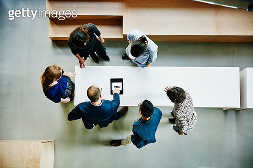 Business colleagues discussing project in office - gettyimageskorea