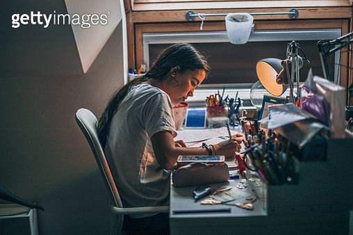 young  woman doing homework at home - gettyimageskorea