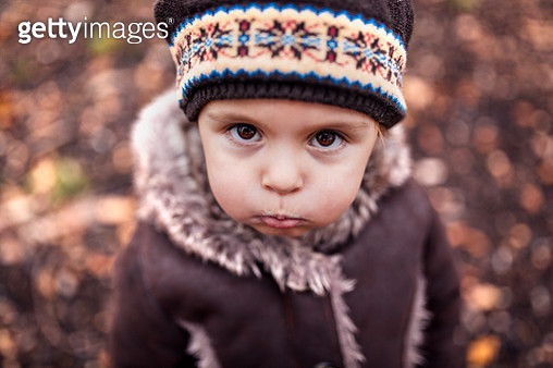 Portrait of pouting little girl in autumn - gettyimageskorea