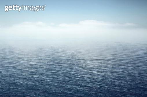 a calm sea fading into the sky - gettyimageskorea