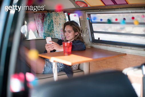 WS Young woman on a road trip in a vintage camper van - gettyimageskorea