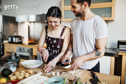 Mature couple preparing food for dinner - gettyimageskorea
