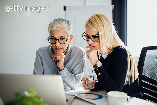 Business women looking at laptop - gettyimageskorea