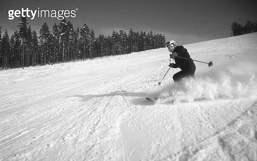 Girl Skiing On Snowy Field Against Sky - gettyimageskorea