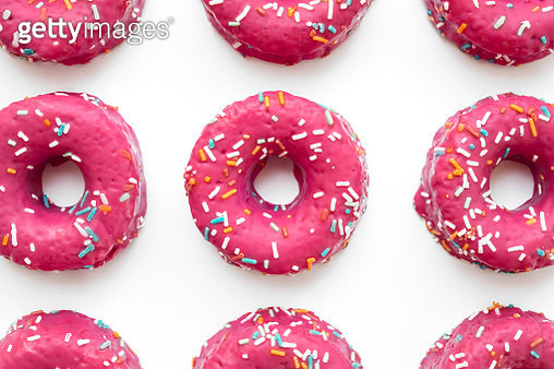 Close-Up Of Donuts On White Background - gettyimageskorea