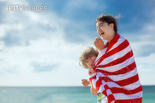 Two kids  happy at beach wrapped int a towel - gettyimageskorea