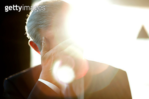Senior businessman with hand over face - gettyimageskorea
