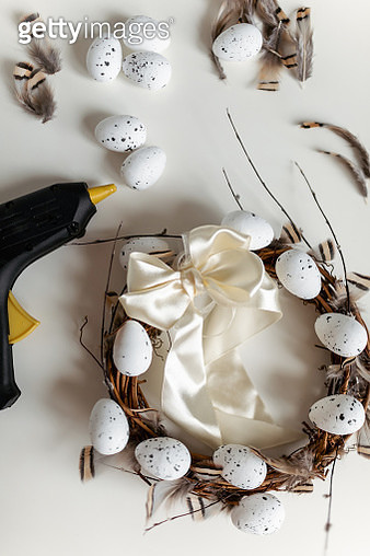 Hand crafted Easter wreath on white background and tools. - gettyimageskorea